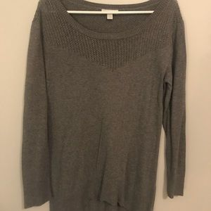 Over sized grey sweater.